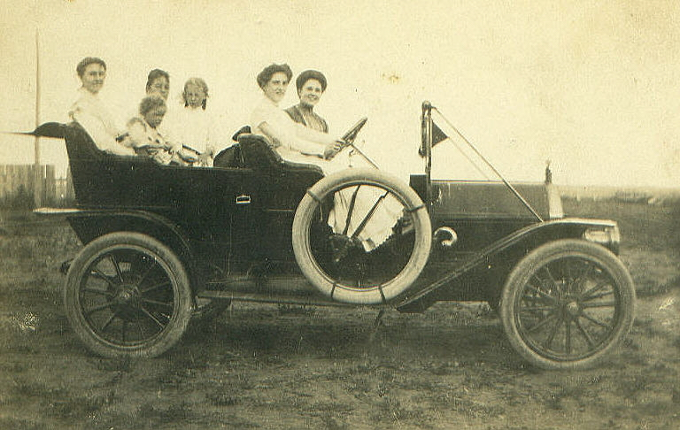 Dolores in Old Car With Friends